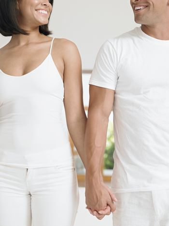 Midsection of an affectionate young couple holding hands