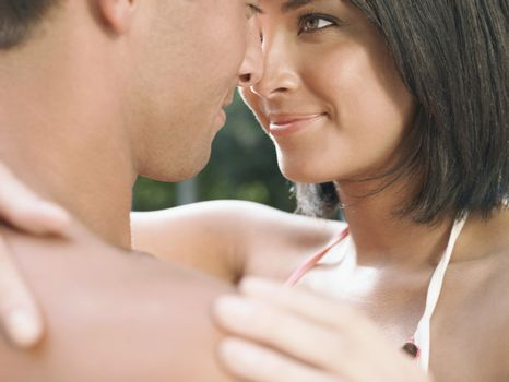 Closeup of a young couple face to face