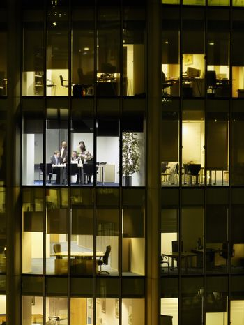 Group of business people at meeting in office view from building exterior