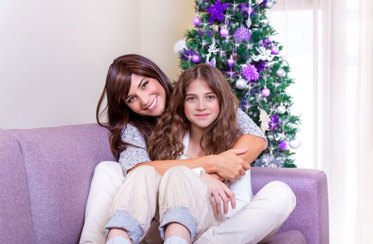 Mother with daughter on Christmas eve