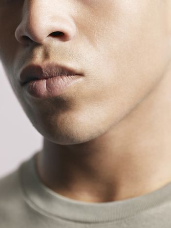 Young man close-up of mouth