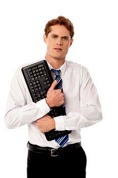 Corporate man holding keyboard