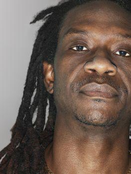 Mid adult man with dreadlocks close-up