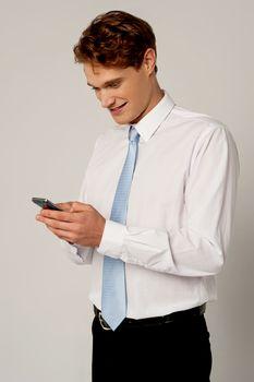 Businessman reading a text message