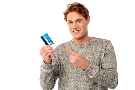 Guy pointing at his credit card