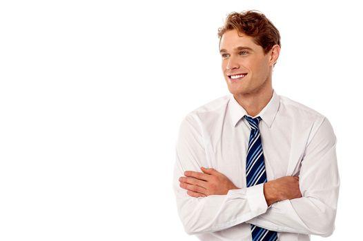 Young business executive looking away