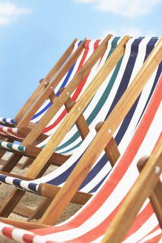 Row of deck chairs on beach