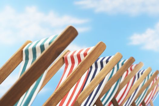 Row of deck chairs on beach close up