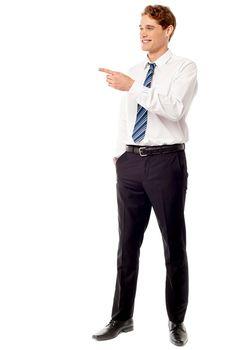 Businessman pointing away