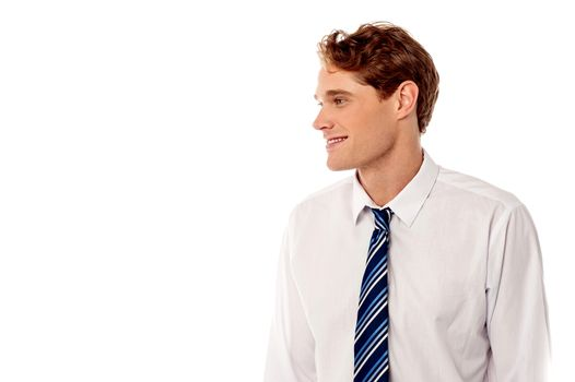 Smiling corporate guy looking away