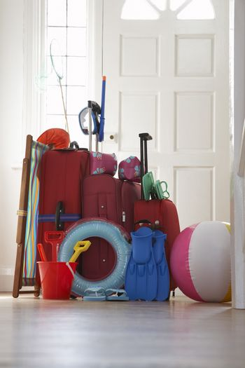 Packed luggage standing in hallway