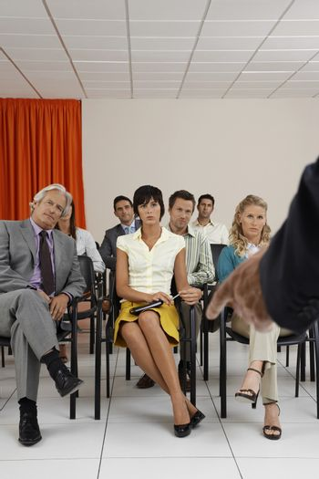 People listening to a seminar in conference room