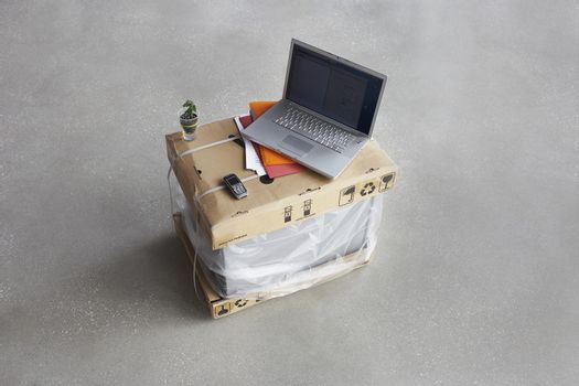 Elevated view of open laptop on top of boxes