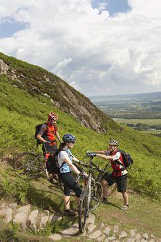 Three cyclists on hill