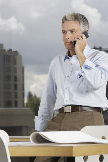 Businessman using cellphone in the office