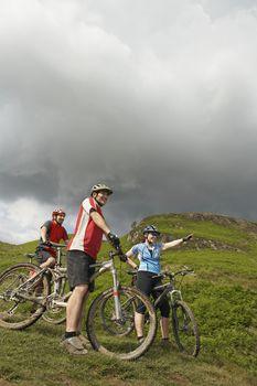 Three cyclists on hillside