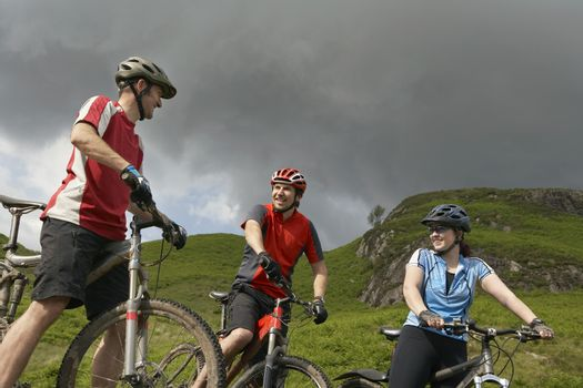 Three cyclists in countryside