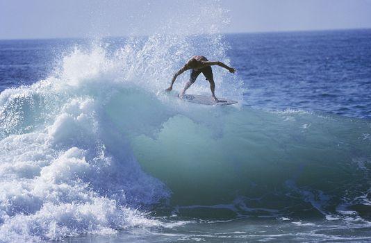 Man surfing on ocean wave
