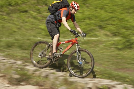 Male cyclist on track in countryside