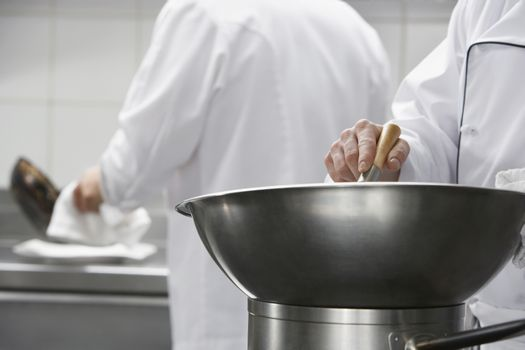 Closeup of a chef mixing ingredients in a bowl