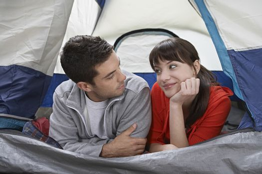 Couple lying side by side in tent