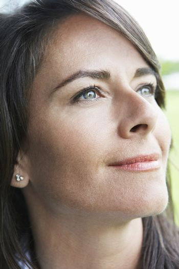 Closeup of woman smiling while looking away