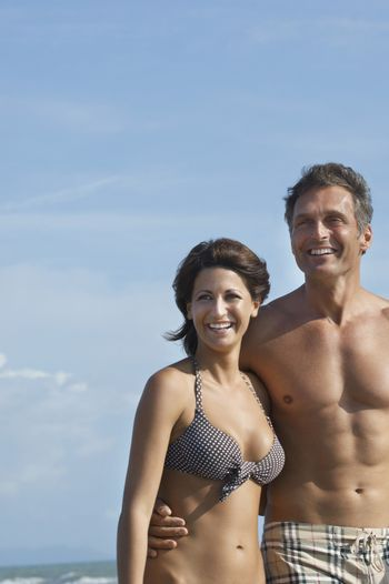 Portrait of couple on beach laughing