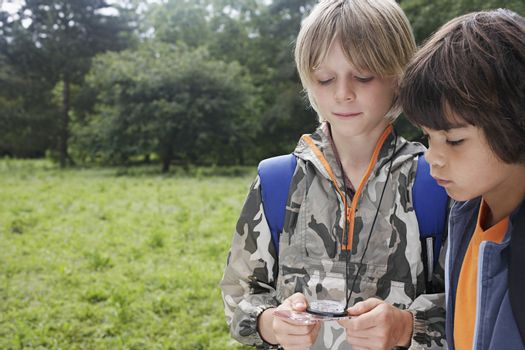 Two boys (7-9) using compass