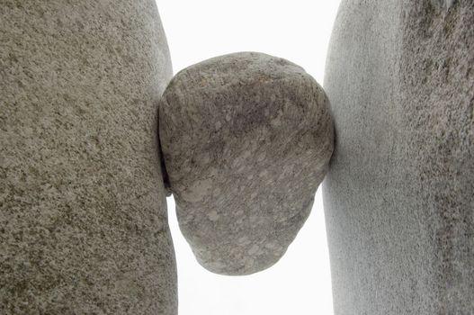 Rock wedged between two boulders