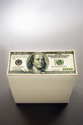 Pile of one hundred dollar bills studio shot elevated view