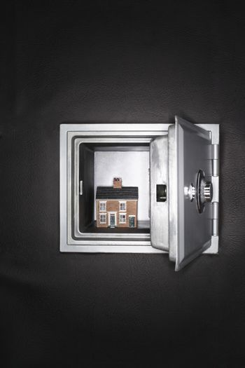 Ceramic house in opened safe