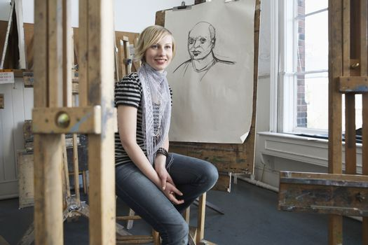 Portrait of smiling female art student in art studio