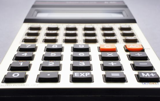 Close-up of old calculator selective focus