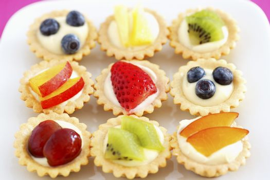 Selection of mini fruit cupcakes elevated view