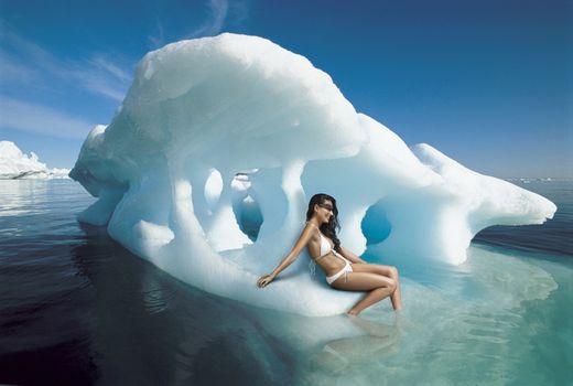 Woman Sitting on Iceberg