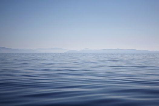 Ocean with hazy mountain shore