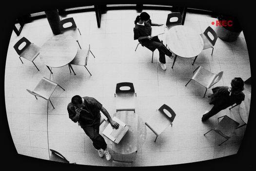 View of three nurses in hospital canteen through surveillance screen