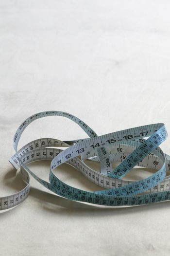 Measuring tape on table elevated view