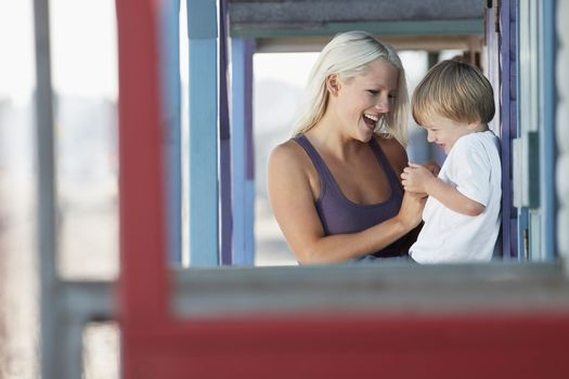 Cheerful mother and son at porch