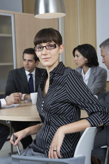 Business woman in office meeting portrait