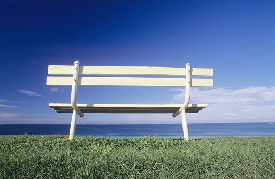 Seat overlooking ocean Victorian coastline Australia