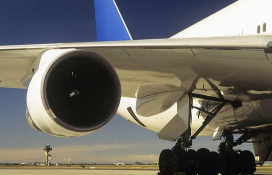 Man inspecting engine of passenger jet