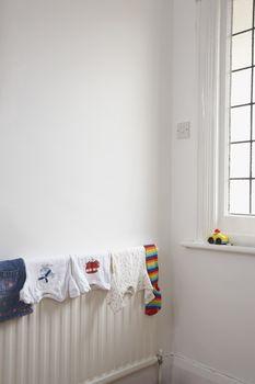 Child's clothing drying on radiator