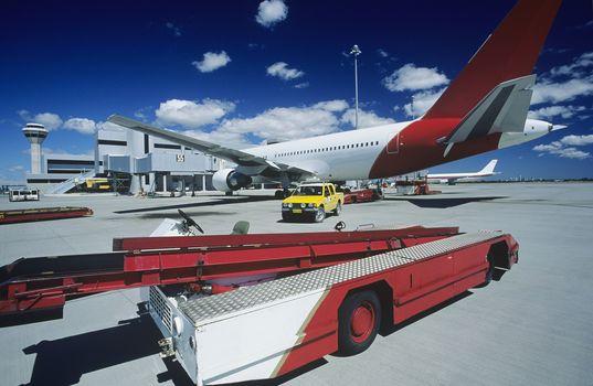 Cart near aeroplane at airport Perth Australia