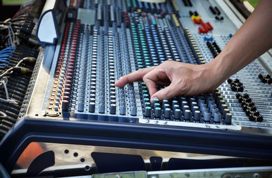 Sound engineer works with sound mixer
