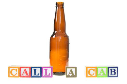 Letter blocks spelling call a cab with a beer bottle. Isolated on a white background.