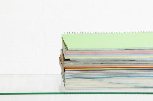 Stack of coloured stationery studio shot
