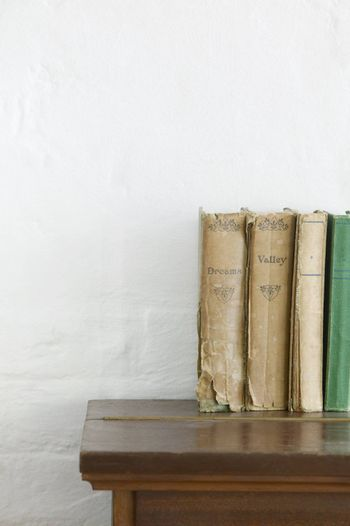 Old books on wooden chest
