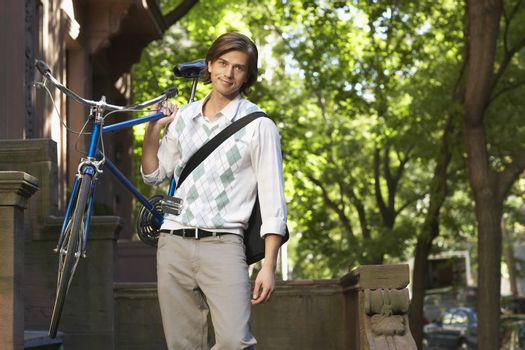 Man carrying bicycle portrait