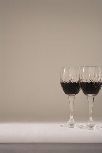 Two glasses of red wine on table